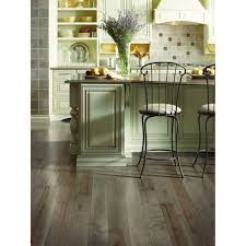 never lay wood flooring whether hardwood or laminate on top of tile