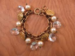 on jewelry upcycled ons police coat on vintage chandelier crystal and creamy pearl