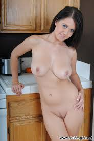 Busty Babe Chrissy Marie with Plump Pussy in Kitchen Image.
