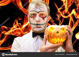 devil make up festive scary makeup man with pumpkin for celebration photo by dzmitrock87 gmail