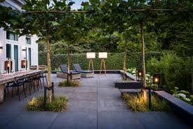 terrace lighting. Roof Terrace With Concrete Tiles And Shaped Trees. Lighting Is Applied Under The Trees By Means Of Uplighters. On Ville Use Wall Fixtures I