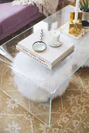 loving the clear coffee table s that k through underneath and candle holders