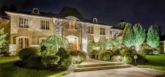 luxury home with beautiful landscaping and lighting exquisite residential landscape lighting