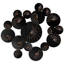 black discs with gold designs wall art