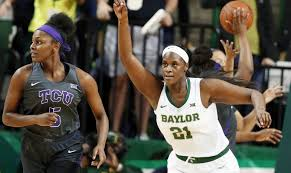 baylor center kalani brown right reacts to her score while heading up court with