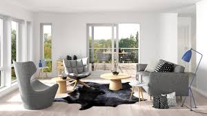 small formal living room in the scandinavian style with classic scandinavian style gray furniture centered around