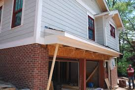 after they wrapped up the roof there they moved to the back to tackle the two roof structures at the back doors
