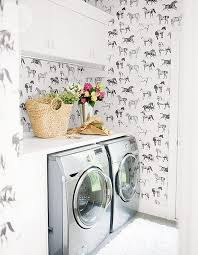 The bold, horse printed wallpaper gives this laundry room personality!