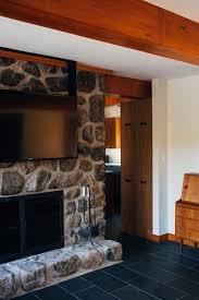 mounting your tv over the place you could maybe go for a swivel mount to improve the angle if you are extremely particular about the fireplace tv