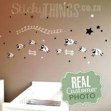 the sheep baby room wall sticker is 8 sheep jumping in a line over 2 fences