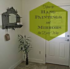 the easy way to hang large paintingirrors
