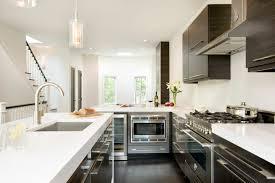 white stone countertops fantastic modern silver hardware kitchen with undermount sink and dark wood flooring with dark wood cabinets