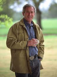 president george w bush poses for artist robert anderson a portrait painter and former yale classmate march 30 2002 at prairie chapel ranch in crawford