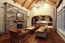 Elegant Country Family Living Space With Wood Beams High Vaulted Ceiling  And Natural Stone