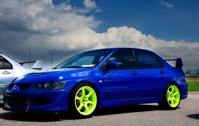 mitsubishi evo 8 blue. with colored wheels other than gold or silver lip black orange green thats anew one for sure here random shots to get you started good mitsubishi evo 8 blue a