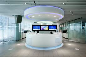 beautiful futuristic round front office table with exciting flat television as background and amazing glass bulkhead beautiful office desk glass