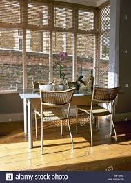 wood colours for furniture. Modern Kitchen Dining Area Wood Floor Metal Table Woven Wicker Chairs Venetian Blinds Interiors Rooms Square Bay Windows Neutral Natural Colours Mate For Furniture