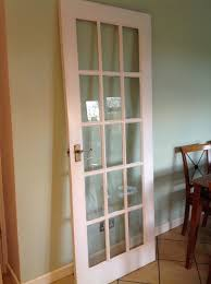 wooden white painted internal glazed glass door 15 panels hinged handles surrey
