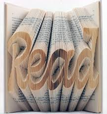 book art fold the pages to create words now to figure out how to fold those pages