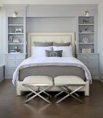 stunning transitional open shelf bedroom features bed head board and upholstered head board paired built in bookcases white duvet bedroom is master bedroom