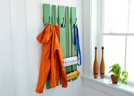 build storage for outerwear with this diy rack that lies flat on a wall this mounted piece can fill up empty vertical space and is the perfect solution to