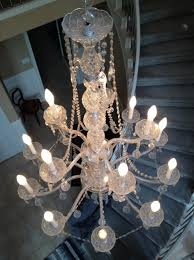 result an elegant crystal chandelier that brought big smiles to our client all light bulbs are burning brightly on the chandelier and the livingroom has