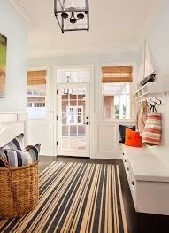 mudroom rug with themed sculptures entry beach style and bench