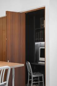 Compact home office Small View In Gallery Foldout Wooden Doors For The Compact Home Office Decoist Small Contemporary Kitchen Makes Room For Home Office And Laundry
