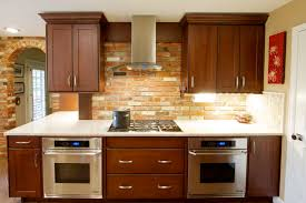 Brown Cabinetry With Kitchen Hoods Design Ideas Has Rustic Ceramic  Backsplases Also White Granite Countertop In ...