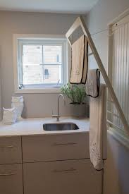 toronto diy laundry rack with transitional clothes drying racks laundry room and potted plant stainless sink