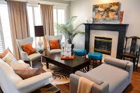 black painted fireplace with solid base coffee tables living room eclectic and art above fireplace