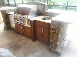 concrete floor with wooden cabinet and small undermounted stainless steel sink for perfect outdoor kitchen storage solutions