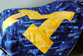 Mitten to Apple & As a University of Michigan grad, I wanted to use my new quilting obsession  to make a fun, scrappy quilt for him. Adamdwight.com