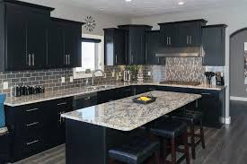 Contemporary kitchen with black cabinets, island and giallo verona granite  counters