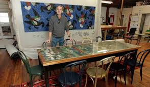 fine dining simon ogden with the table and matching rug for exhibition at martin bosley s