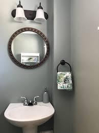 60 dollar little bathroom facelift light fixture runnings 30 mirror dollar general 10 soap dispenser kohls 10 round towel holder aldis 3