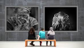 women looking at an art gallery exhibition