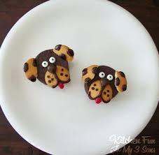 we made these cute little doggies using pre made hostess ding dong cakes and vanilla wafers just something fun we decided to make one day