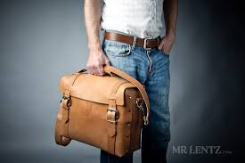 holding the large handmade leather briefcase