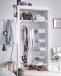 Turn an alcove into a storage area with a clothes rail, shelf and some  baskets