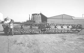 """Swather """"Expert"""" Builds Big Cutting Tables"""