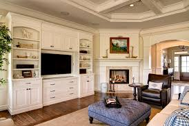 built ins around fireplace family room traditional with built in cabinetry area rug