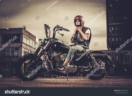 tattooed biker his bobber style motorcycle stock photo 269415932