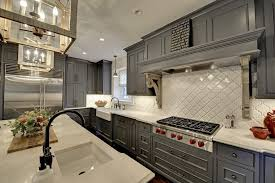 minneapolis beveled arabesque tile kitchen traditional with large lantern in contemporary cooktops white island