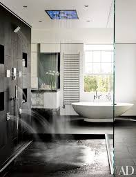 ideas shower systems pinterest: a sleek master bathroom with a free standing tub and a rain shower system