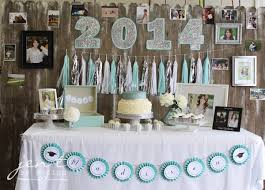 If you're looking for grad party ideas for girls, take inspiration from  this beautiful dessert table featuring sparkly silver and turquoise  decorations.