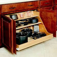 keep your pots and pans organize by making a cabinet that can be pullet out 34 insanely smart diy kitchen storage ideas