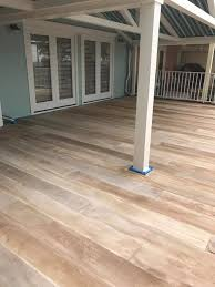exterior quality concrete floor paint. concrete floor stained to look like a wood floor! i love this! exterior quality paint