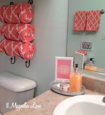 Coral and aqua is an unexpected color combination that works well in a girl's  bathroom and