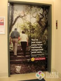 Door Wraps Custom Eye Catching Elevator Wraps Spokane Signs For Success